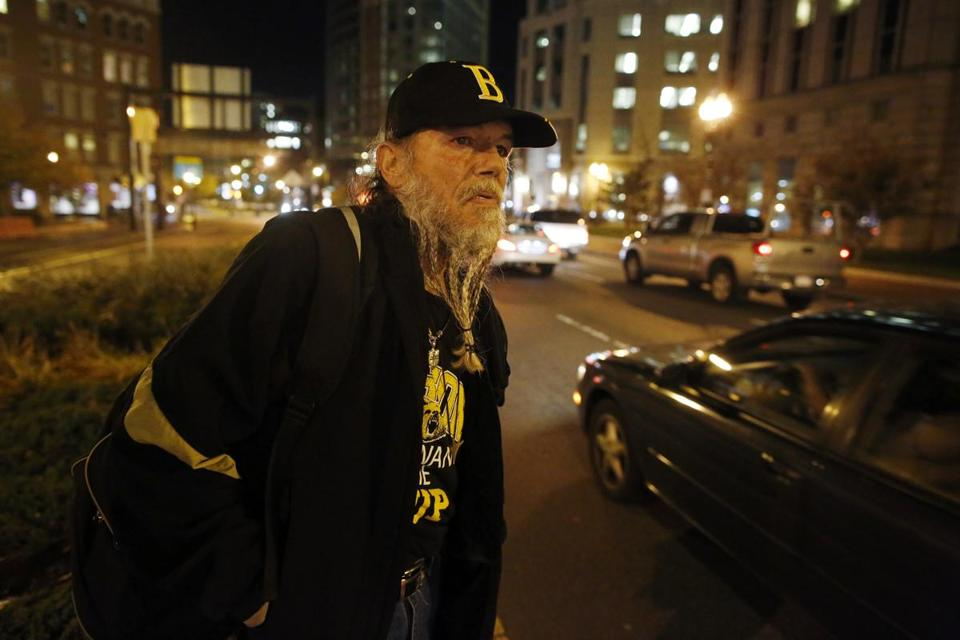 David Reid, who said he lived on the streets for seven years, helped distribute space blankets in downtown Boston as the weather turned cold.